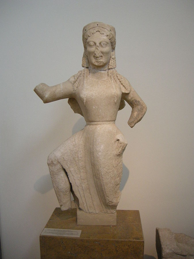 Statue of Nike from Delos, with arms and legs bent at sharp angles