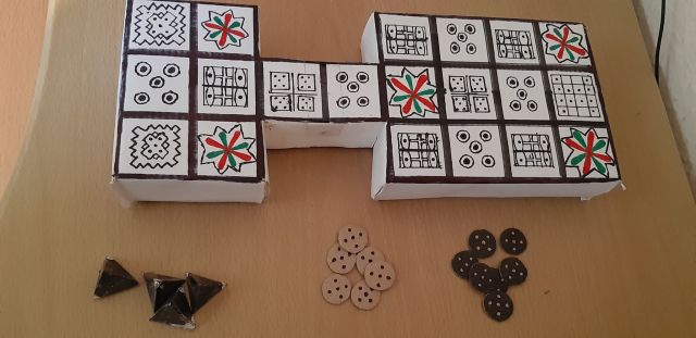 A homemade version of the Royal Game of Ur, an ancient board game from Mesopotamia, made of cardboard and pen.