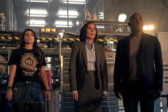 "TIMELESS -- ""Pilot"" -- Pictured: (l-r) Claudia Doumit as Jiya, Sakina Jaffrey as Agent Christopher, Paterson Joseph as Connor Mason -- (Photo by: Joe Lederer/NBC)"