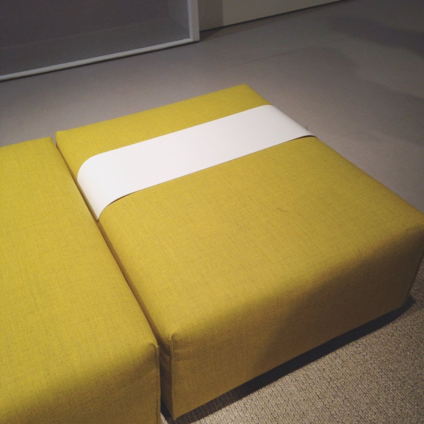 Yellow pouffe with space for your coffee cup.