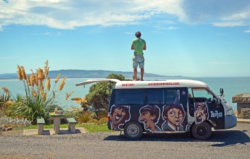 artistically painted camper van with The Beatles style
