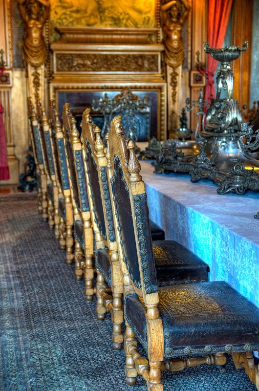 Carved Wooden Chairs and Banquet Table