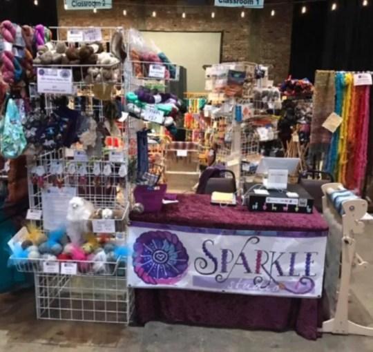 SPARKLE Studio booth at a fiber festival