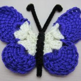 a blue and white crocheted butterfly, pattern 1