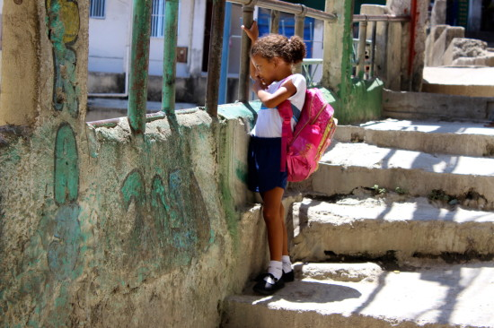 A young girl that is on her way to school