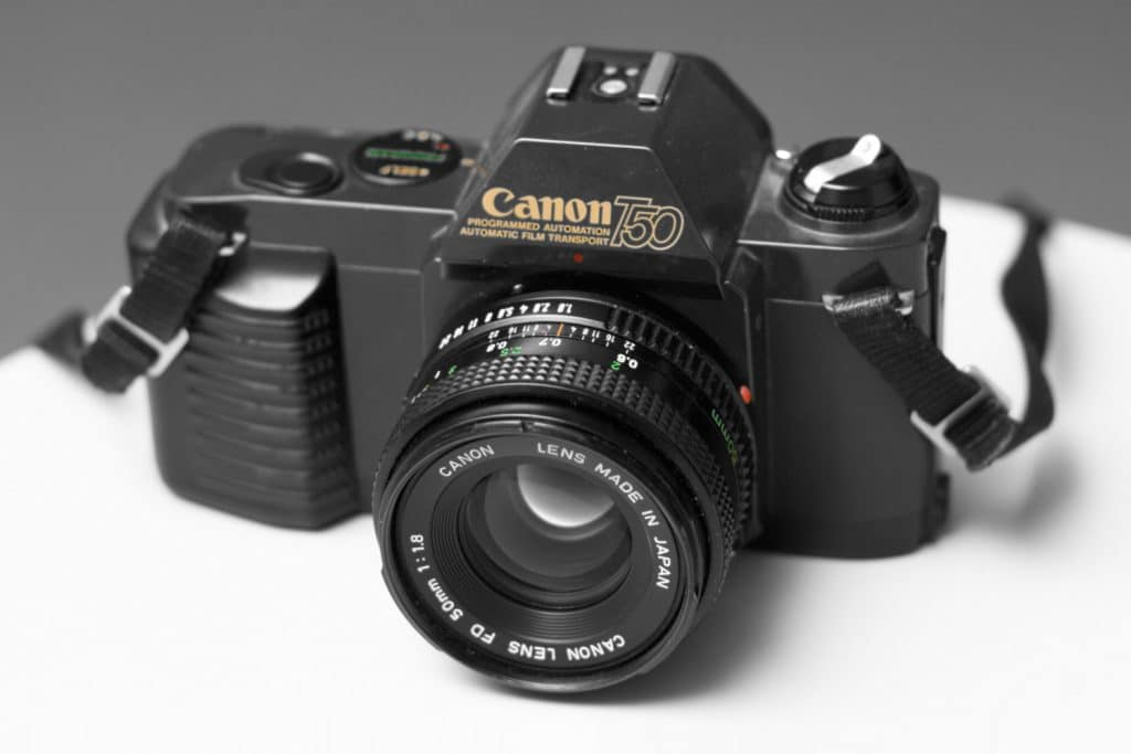 Canon T50 SLR camera with Canon FD 50 mm f/1.8 lens