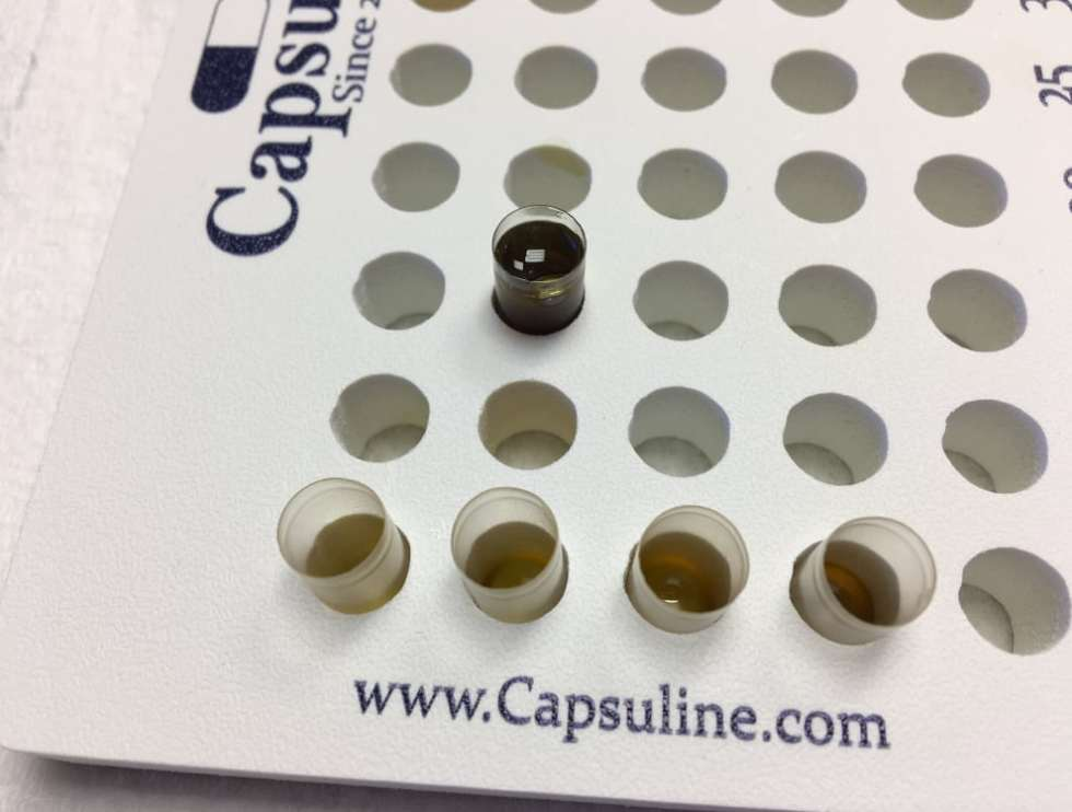 Varying levels of infused oil in capsules for microdosing.