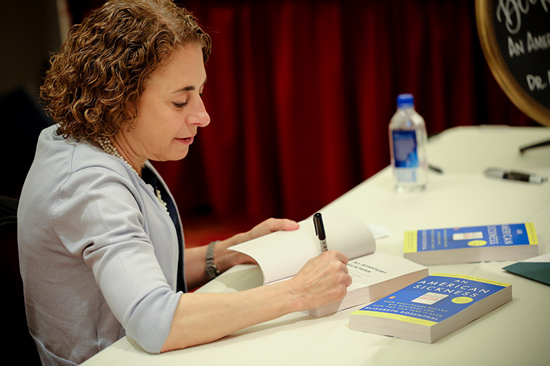 """Elisabeth Rosenthal signing her book """"An American Sickness"""""""