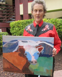 "Temple Grandin with Kevin Hosseini's ""Cow"" painting"