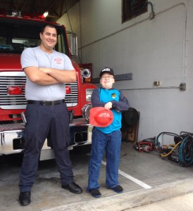 Bryan and the firefighter. Bryan's Christmas day his wish came true to be a policeman for the day.