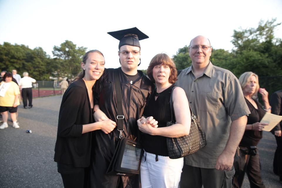Nick and his sister and parents on graduation day