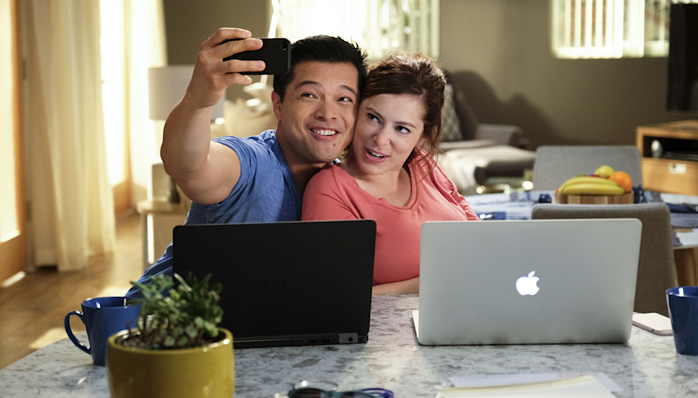 """Crazy Ex Girlfriend -- """"Will Scarsdale Like Josh's Shayna Punim?"""" -- Image Number: CEG210b_0024b.jpg -- Pictured (L-R): Vincent Rodriguez III as Josh and Rachel Bloom as Rebecca -- Photo: Scott Everett White/The CW -- ©2016 The CW Network, LLC All Rights Reserved."""