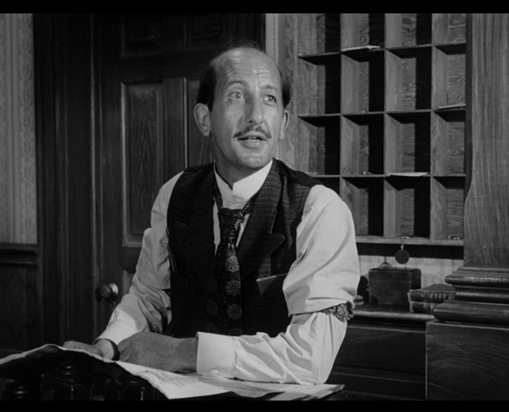 Howland Chamberlain as the hotel receptionist.