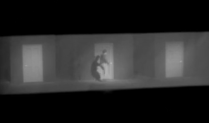 black and white image of a man runs down a hallway of doors tilted on an angle