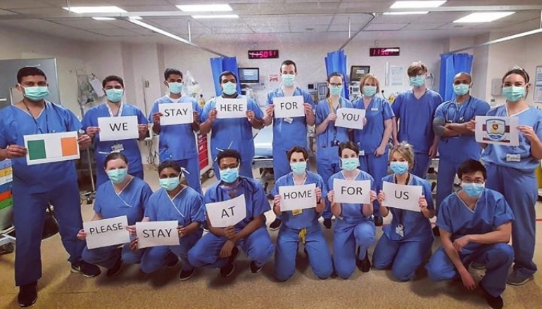 A photo of Irish healthcare workers asking people to stay home while they battle the COVID-19 pandemic.