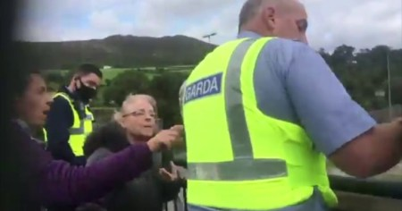 An image of gardaí removing banners in Bray erected by Gemma O'Doherty moments before her arrest under the Criminal Justice and Public Order Acts.