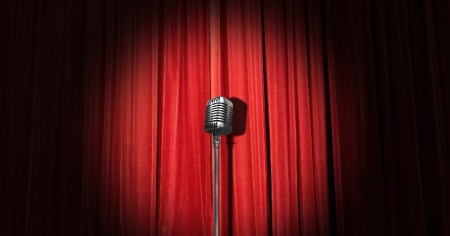 A photo of a microphone stand on a stage, from where comedians can use comedy to tackle social injustice and the far right.