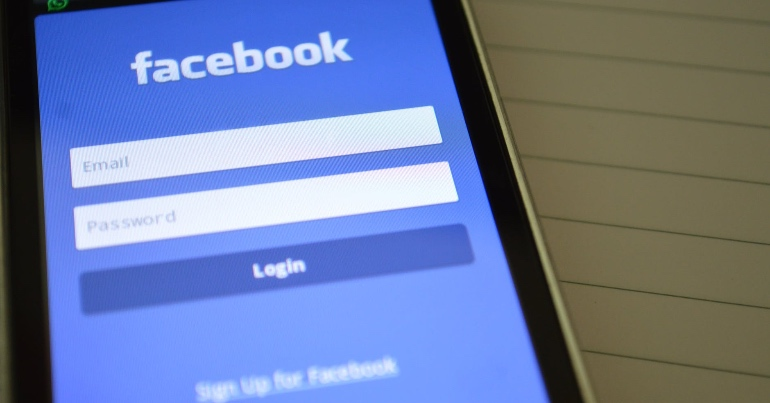 A photo of the Facebook login screen on a phone. A new report has highlighted that the company is failing to deal with disinformation on its platform.