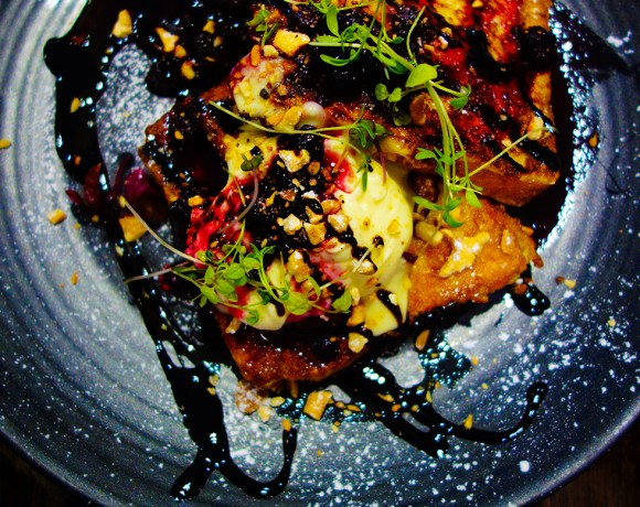 French Toast with bacon, raspberry compote, mascarpone, salted cashew nuts and balsamic glaze