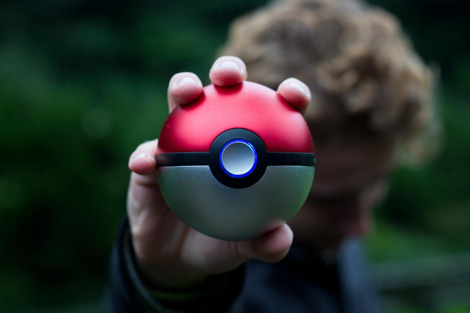 photo of person holding a pokeball