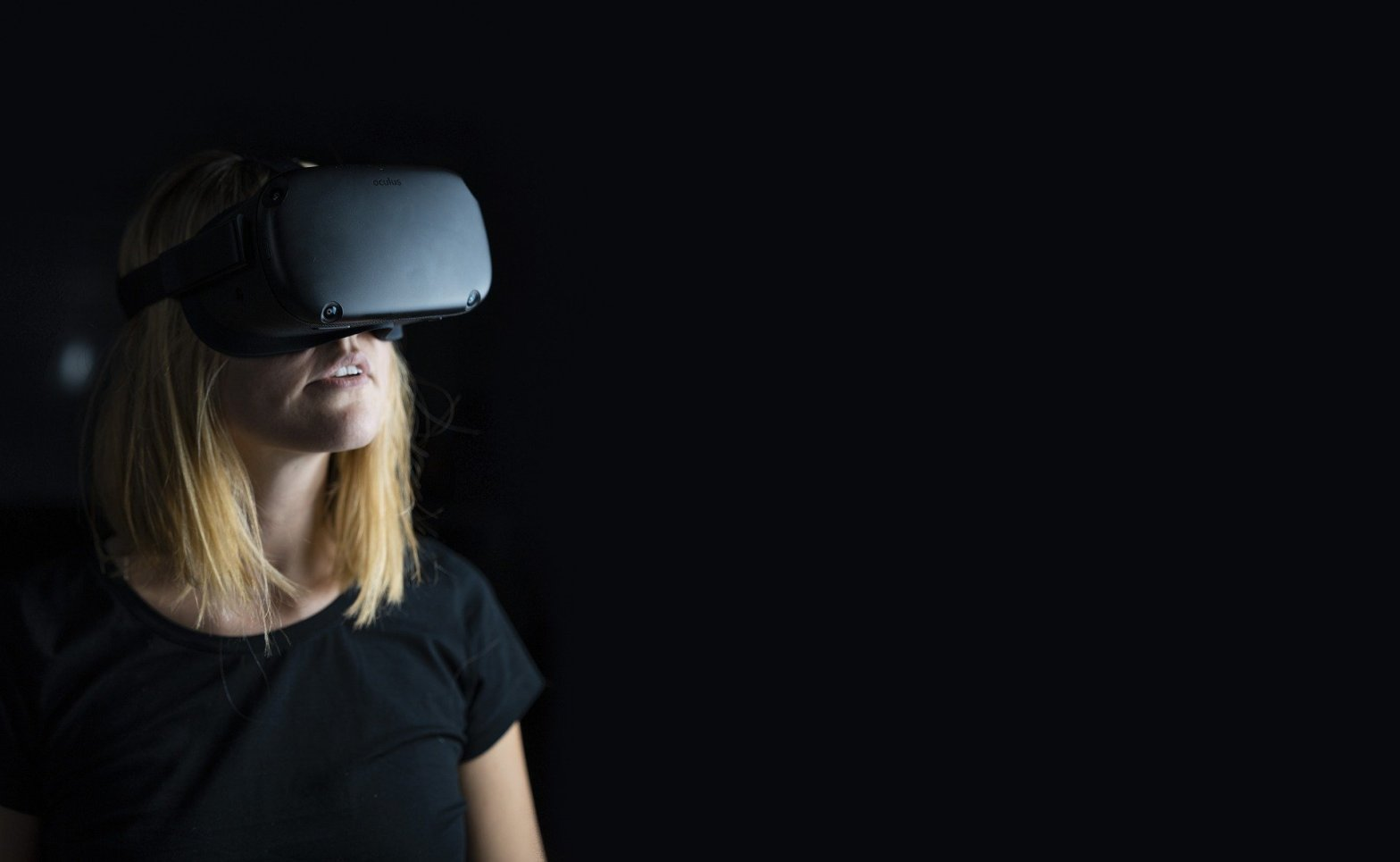 photo of woman wearing a virtual reality headset