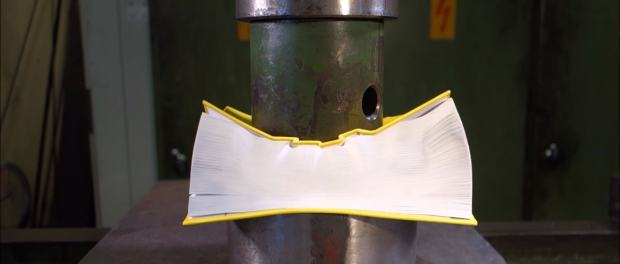 Battle of Hydraulic Press v Book Ends in Pyrrhic Victory (video) Book Culture Books as Art humor