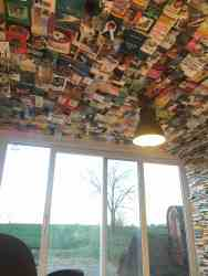 """TV Room """"Wallpapered"""" Top to Bottom in Books Book Culture Paper"""