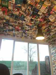 "TV Room ""Wallpapered"" Top to Bottom in Books Book Culture Paper"