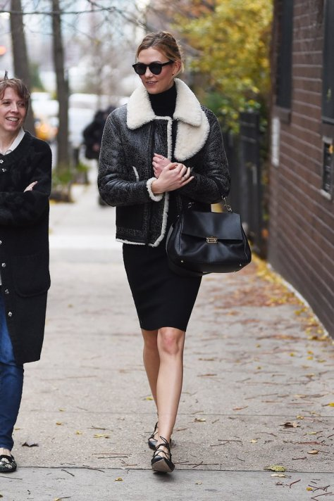 Karlie Kloss stayed warm in NYC with her fur-trimmed leather coat.