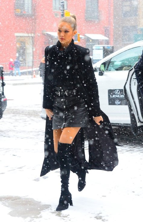 A little snow won't stop Gigi Hadid from wearing over-the-knee boots with her skirt.