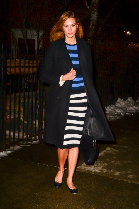 If you're going to wear a dress in the middle of Winter, make sure it covers your knees as in Karlie Kloss's case.