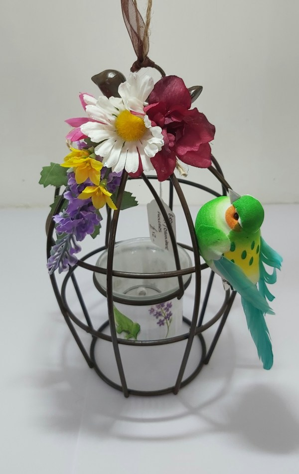 Birdcage with swinging tealight holders