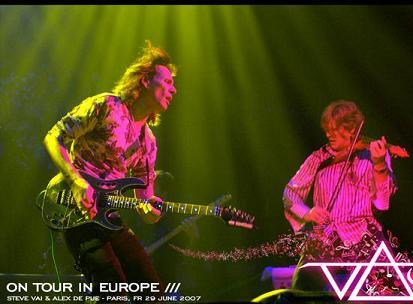"""Steve Vai and Alex DePue on stage """"in action""""."""