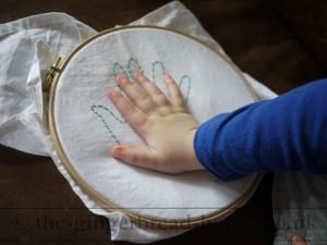 embroidered handprint
