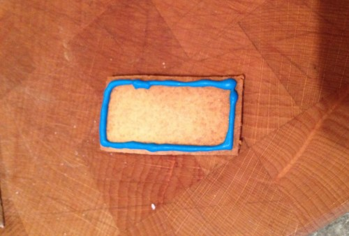 icing a lego biscuit