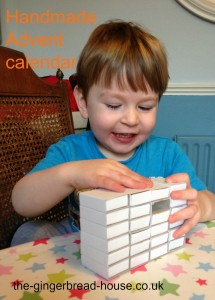 toddler making a matchbox Advent calendar