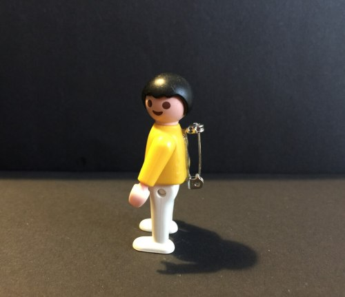 vintage Playmobil figure badge