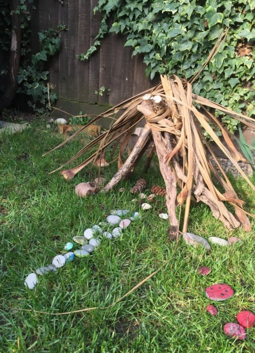 fairy house made from sticks and stones