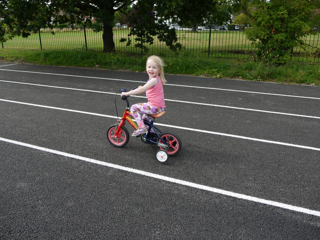 learning to cycle at the running track