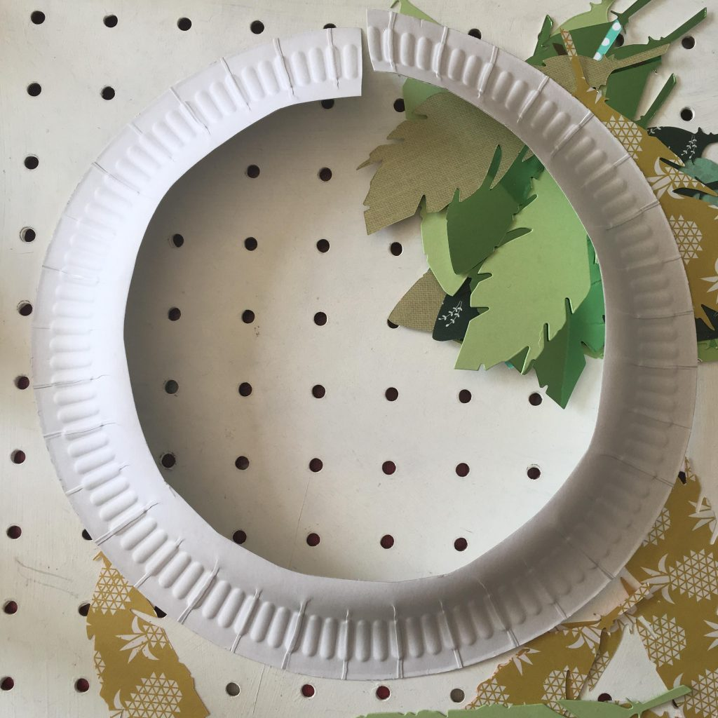 Paper plate laurel wreath craft for kids