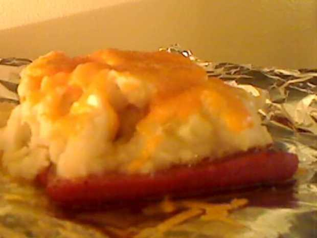 Hot Dogs Covered with Mashed Potatoes and Cheese