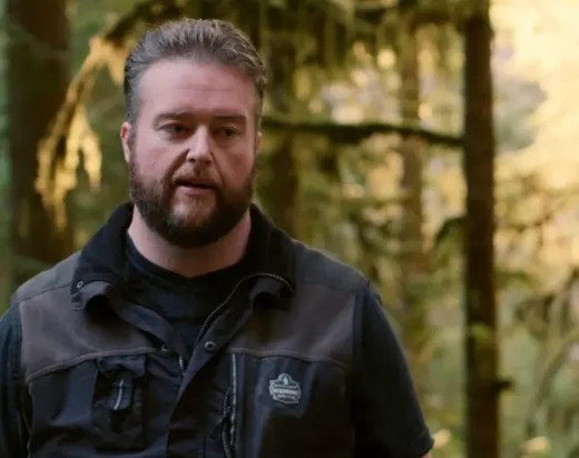 Mike Youngquist Speaks to the Camera in the Woods
