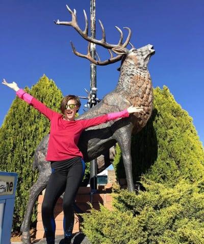 Rain Brown and a Deer Sculptrue