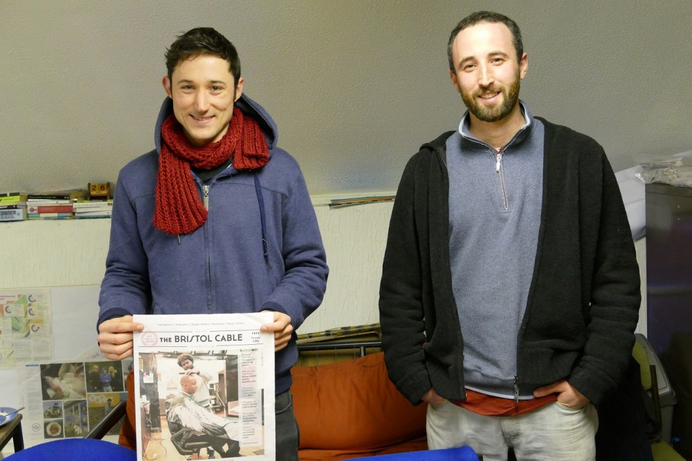 Alon Aviram(right) and Alec Saelens(left) holding a copy of their sixth edition