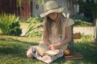 Girl doing summer reading