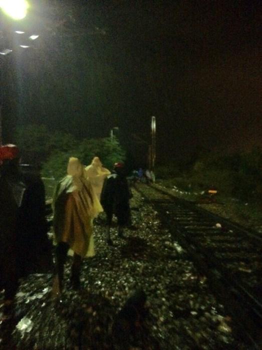 Walking along train tracks at night