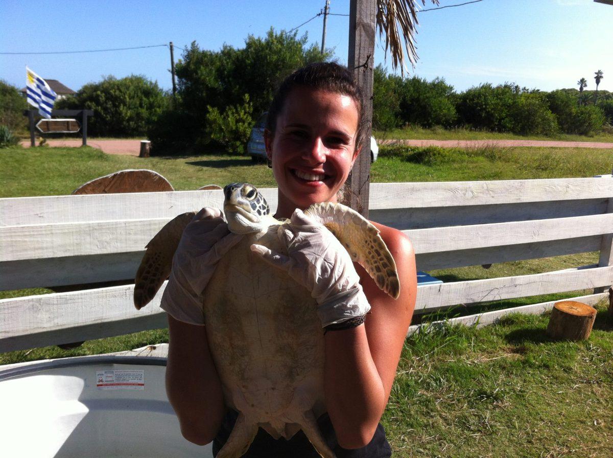 Adriana holding a sea turtle