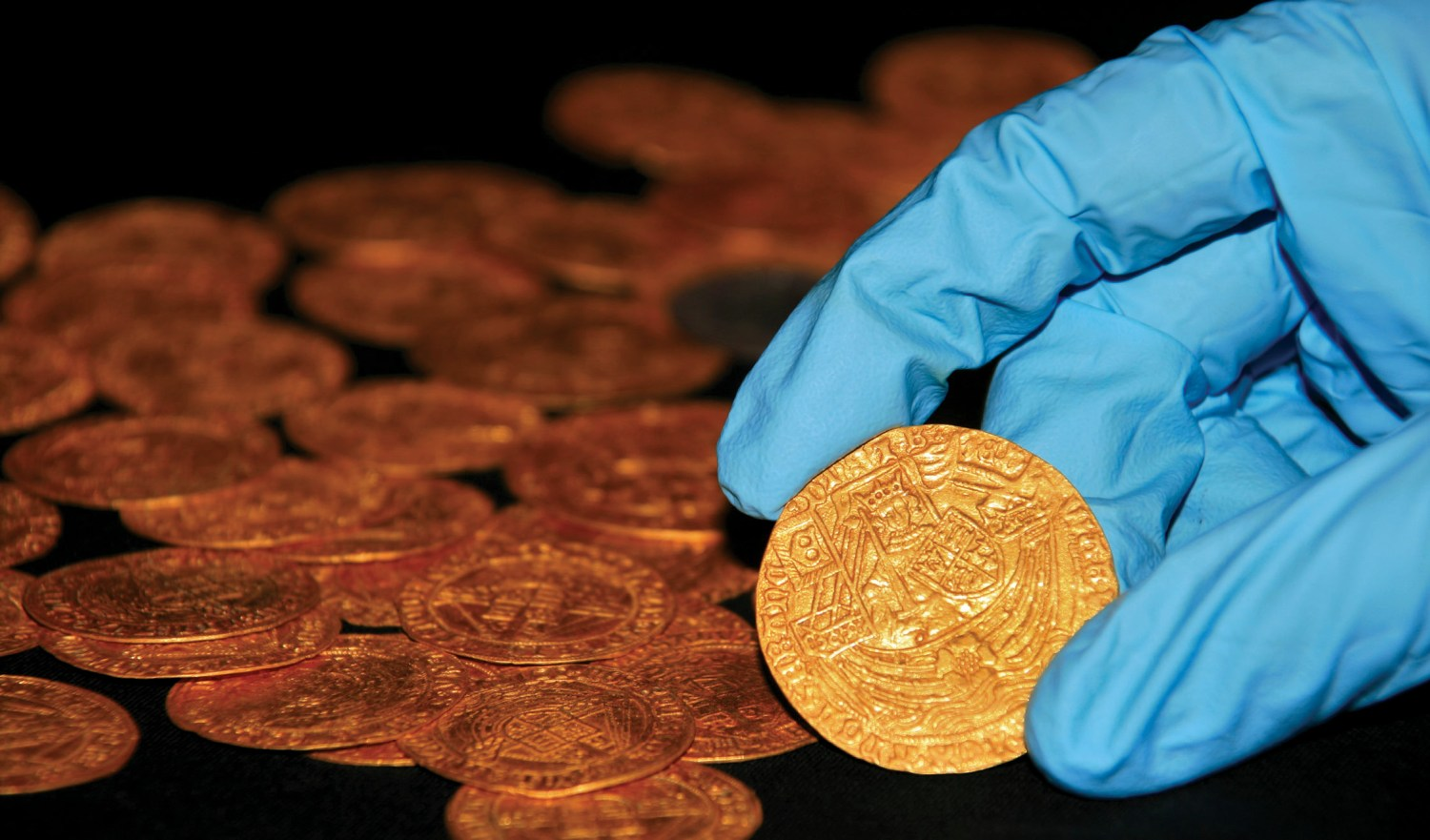 above Gardening during lockdown revealed a hoard of 64 coins from the 15th and 16th centuries in the New Forest area, Hampshire. BELOW This Roman furniture-fitting with the face of the god Oceanus was also discovered in Hampshire.