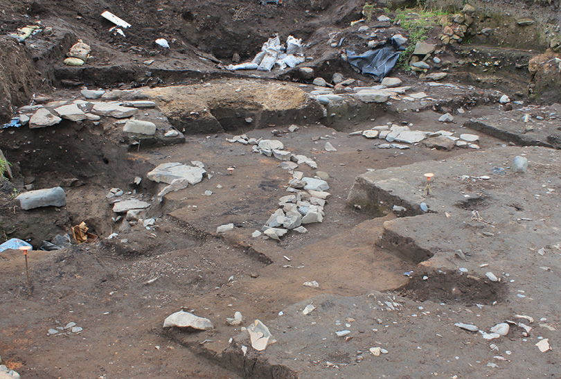 RIGHT Part of the curving foundations of the round-house were revealed beneath an early medieval mortar mixer.