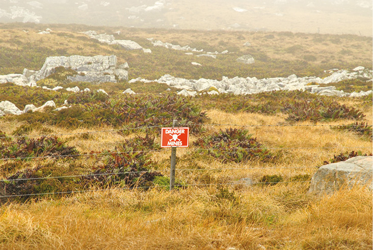 LEFT A sign warning of mines on the Falkland Islands a common sight since the war in 1982.